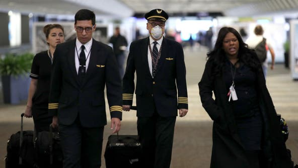 Despite travel warnings, many are flying this Thanksgiving holiday