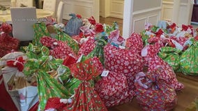 Employees at local company team up to provide Christmas gifts for children in need