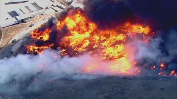 Outside Fire breaks out in Jurupa Valley, setting nearby pallet yard ablaze