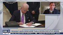 President Biden signs more than a dozen executive orders