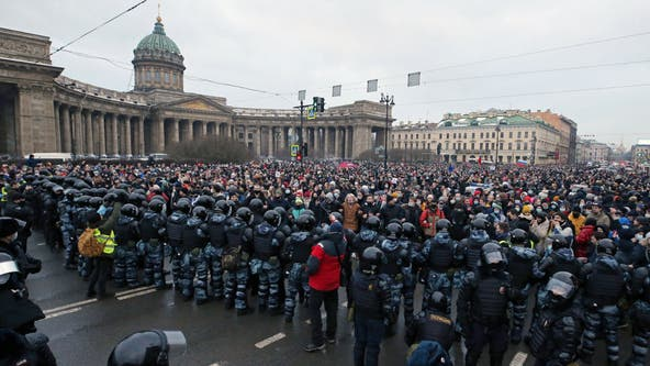 Thousands arrested in Russia at protests demanding release of anti-corruption activist Alexei Navalny
