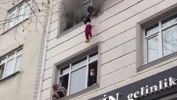 Children plunge from 4th floor of burning building