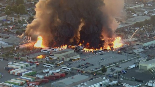 Massive fire burns in industrial area of Compton