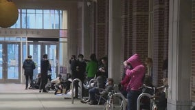 Long line forms at Pennsylvania Convention Center in hopes of getting leftover vaccine doses
