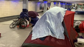 Homeless defend their right to camp at Center City PATCO station, as city cleans the area