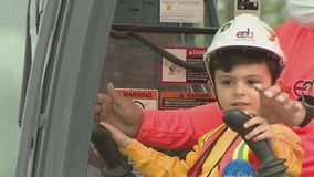 Boy battling cancer becomes construction worker for the day