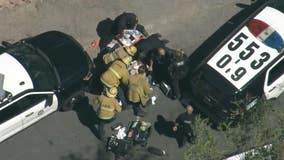 Off-duty LAPD officer shot after suspect breaks into his private vehicle