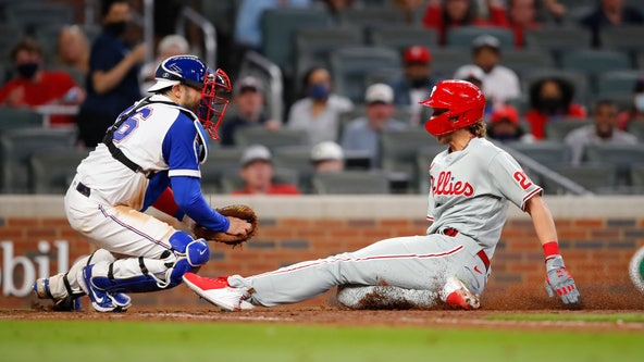 Phillies edge past Braves 7-6 on controversial play at the plate