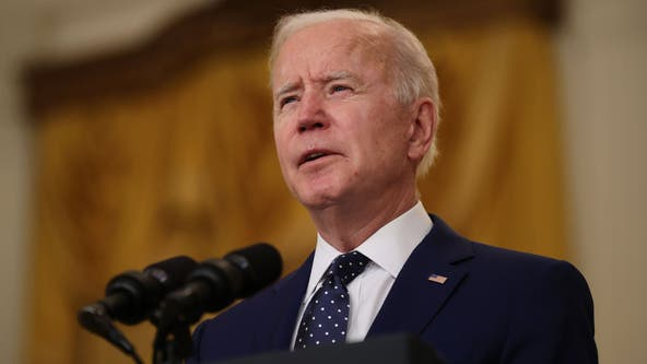 At Earth Day summit, Biden commits to reducing US' greenhouse emissions by at least 50%