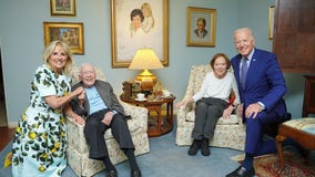 Bidens, Carters pose for a photo during visit to Plains