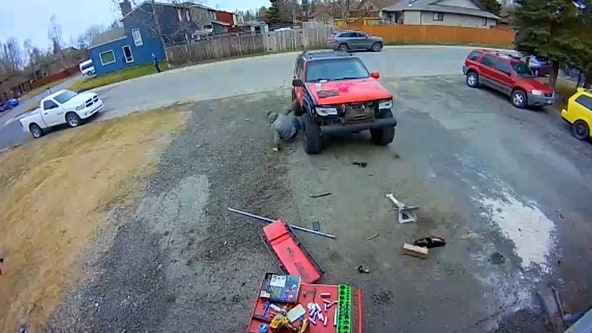 Man working under Jeep gets leg run over after vehicle suddenly starts rolling