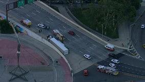 Tractor-trailer flips coming off the Ben Franklin Bridge, tying up traffic