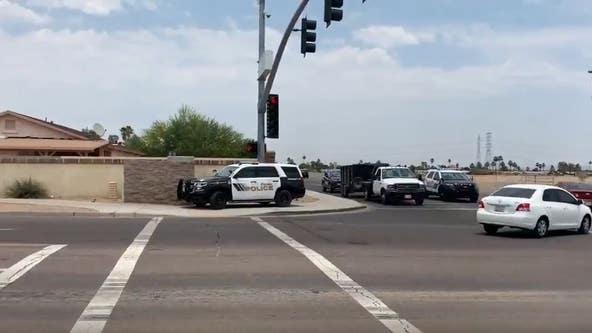 13 injured, 1 dead in Surprise shooting spree; suspect in custody