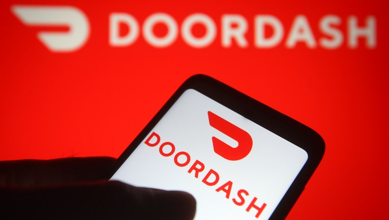 In this photo illustration the DoorDash logo of an US online