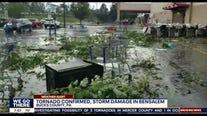 Debris scattered through parking lot of Bensalem Lowes during confirmed tornado