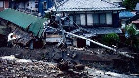 Japan mudslide: 4 dead, dozens missing as rescue crews search through debris