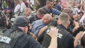 Mount Laurel man seen in video hurling racial slurs taken into custody after day-long protest