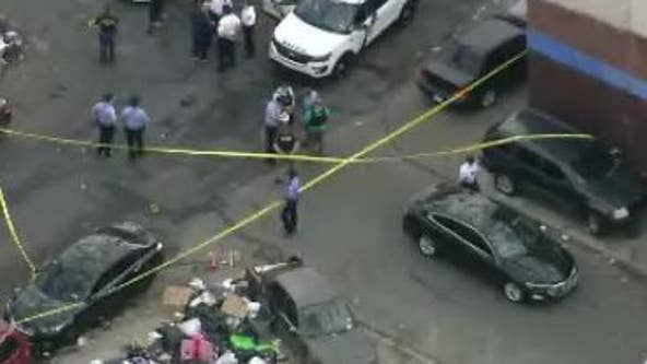 Man accused of firing into crowd in Kensington dies after being shot by officers, police say