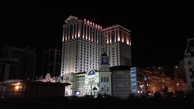 Caesars casino along the Atlantic City boardwalk illuminated at night