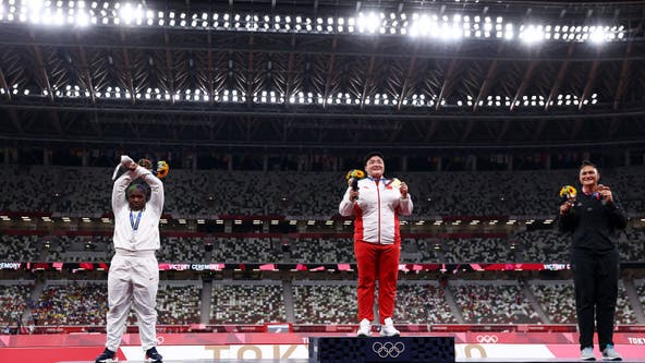 US shot putter Raven Saunders makes 'X' in podium pose after winning silver