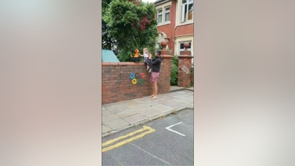 Children recreate Olympic torch relay in UK streets