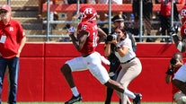 Rutgers suspends 2 football players after paintball shooting