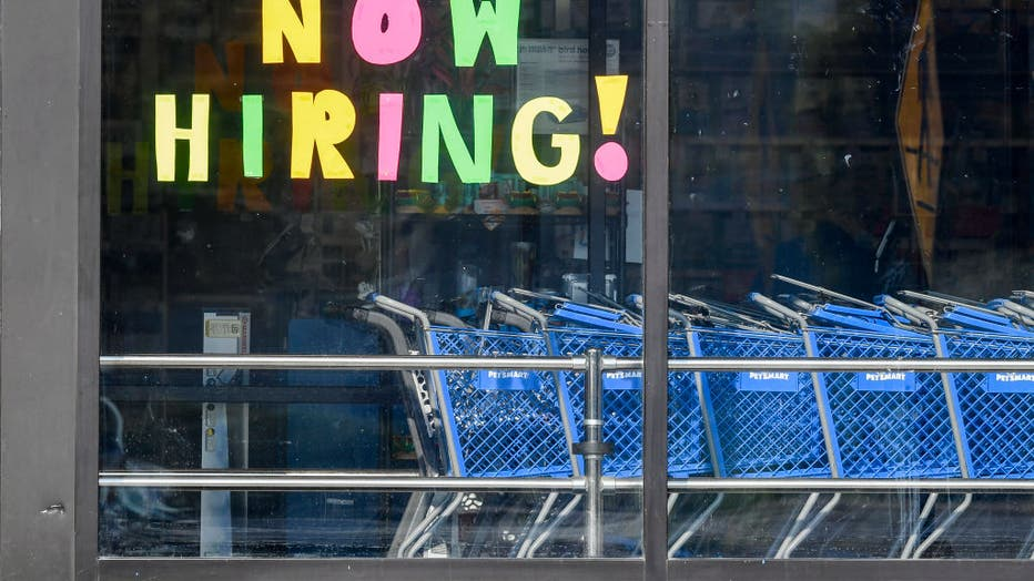 Help Wanted Sign In Store Window In Muhlenberg Pennsylvania