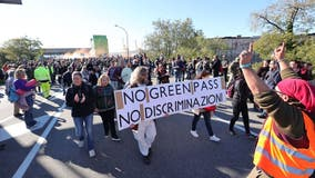 Italy's mandatory COVID-19 pass for all workers prompts protests