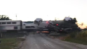 Dramatic video shows Amtrak train crashing into semi-truck car hauler in Oklahoma
