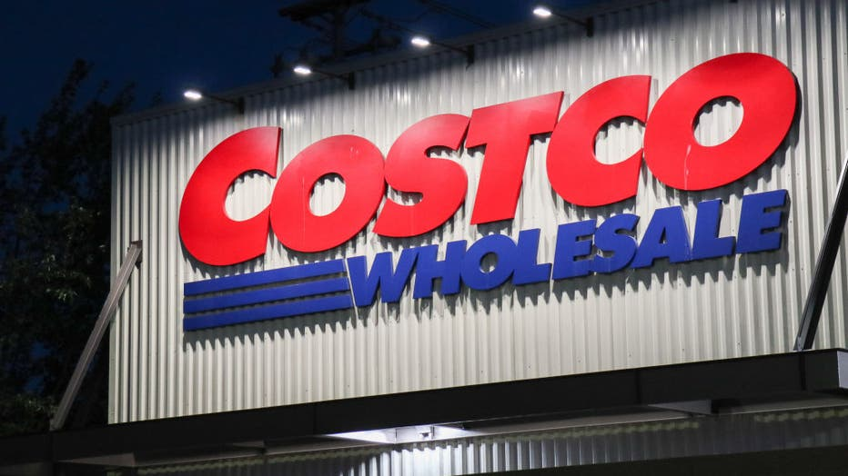 The Costco logo is seen on the exterior of a store in