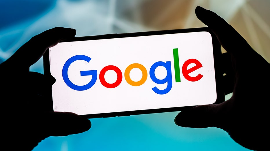 In this photo illustration a Google logo seen displayed on a
