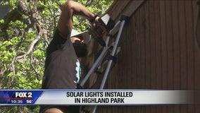 Volunteers install solar-powered streetlights in Highland Park