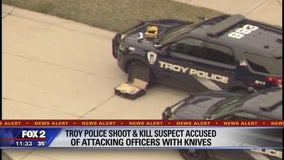 Man armed with knives fatally shot by Troy police