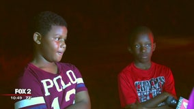 Boys knock on doors to help save families in Romulus apartment fire
