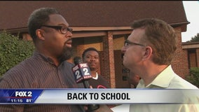 Black men gather to cheer on students returning to school in Detroit