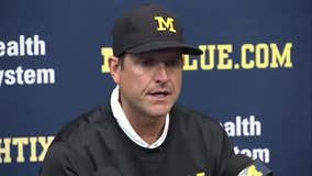 Harbaugh tells players' parents he's not leaving