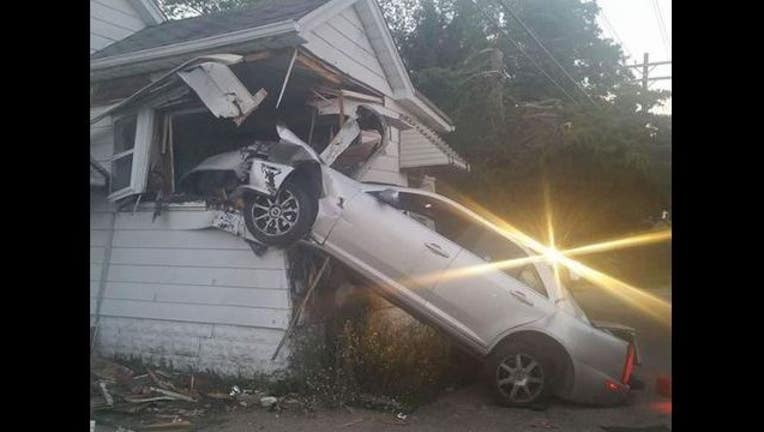 Car vs house courtesy Shelby Twp Police