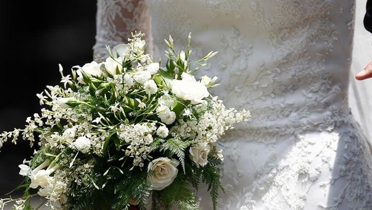e0c3a142-GETTY bride bouquet_1553789661520.png-402429.jpg