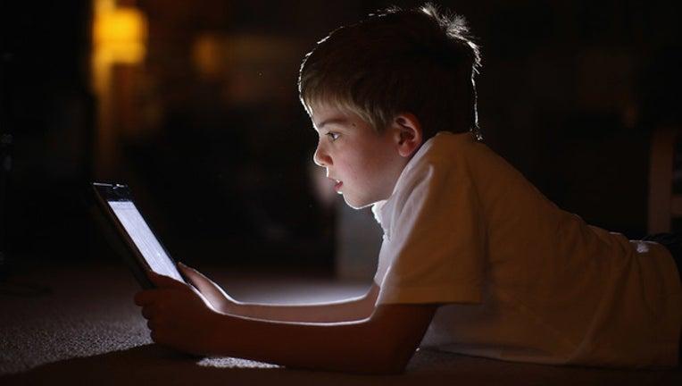 GETTY kid with screen time_1556197562214.jpg-401385.jpg
