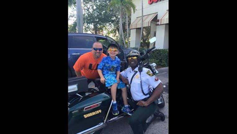 Little boy Buys Officer Breakfast_1442192769450-401096.jpg
