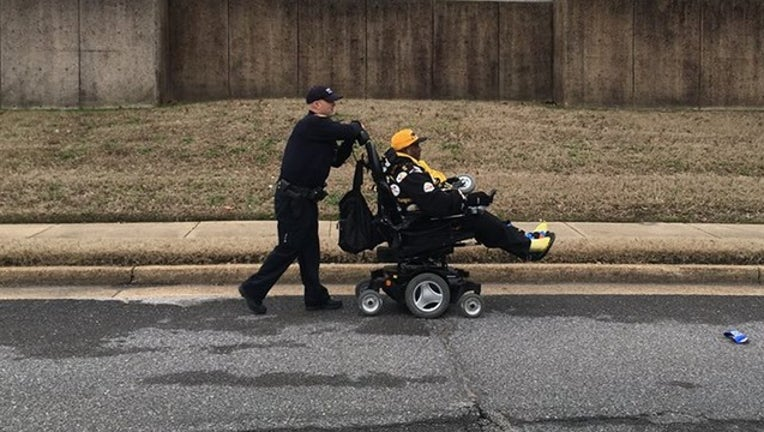 MEMPHIS PD_wheelchair and officer_010619_1546791839874.png-402429.jpg