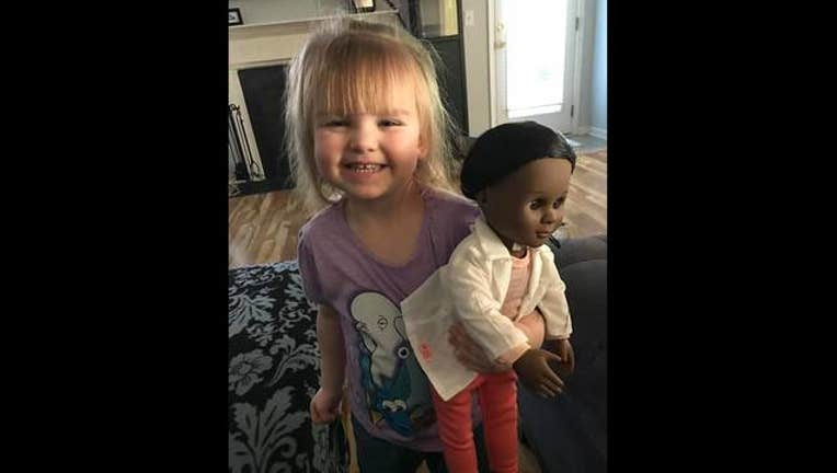 97453d34-Toddler defends doll choice to cashier_1491311686014.jpg