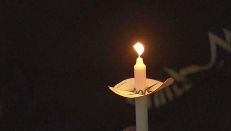 76328b35-candelight vigil flame_1551789992005.jpg.jpg