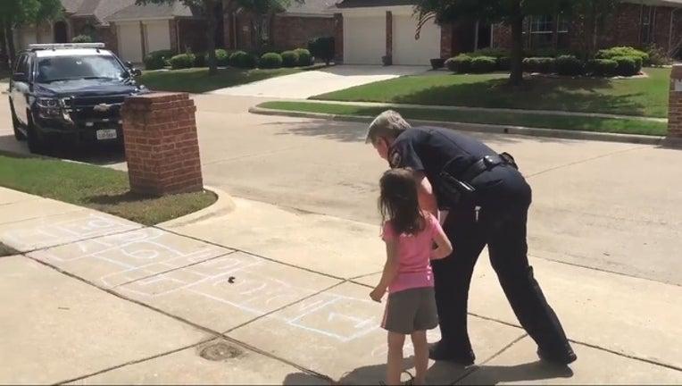 cop plays hopscotch_1492718471191.jpg