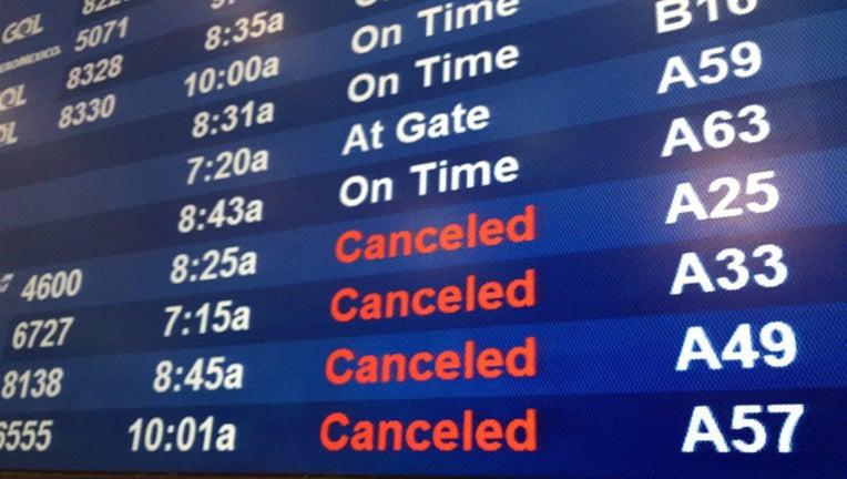 efc4b530-flight-airport-cancel-travel_1489491071538.jpg
