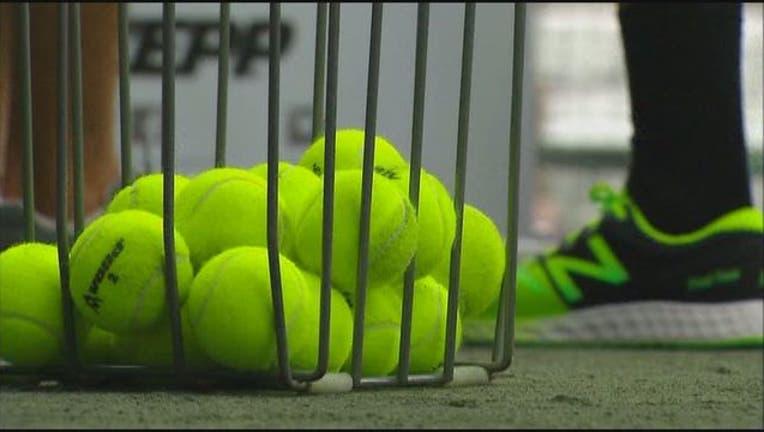 tennis balls_1492627180104.jpg