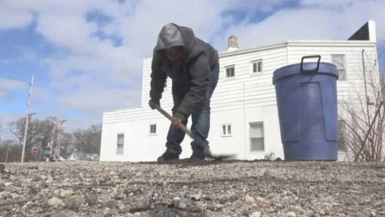 ebb8dc7a-wjbk-12-year-old fixes streets facebook-040119_1554239136325.jpg.jpg