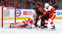 Holland, Oilers beat Red Wings 2-1