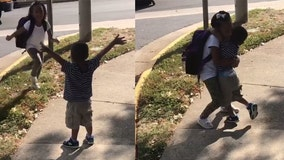 Adorable video shows excited toddler greeting big sister at school bus