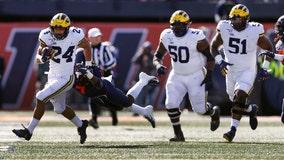 Michigan needs late surge to hold off Illinois 42-25